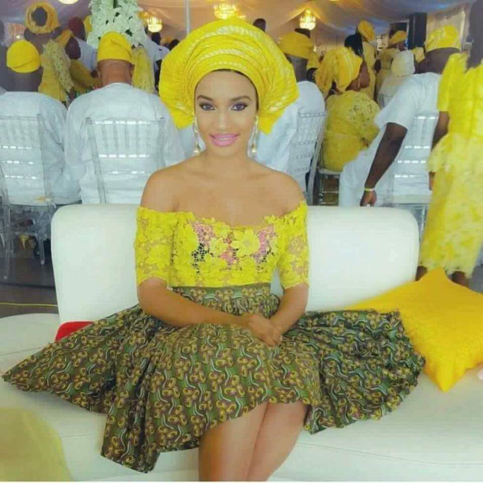 Ankara skirt with lace top styled with gele